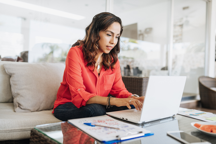 This business woman is happy because she chose the best Internet speed for working at home