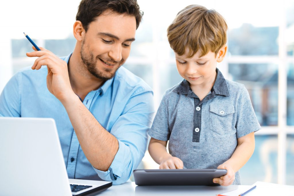 Double your Internet speed for only $10 more per month. This father is working from home while his young son is streaming a show online.